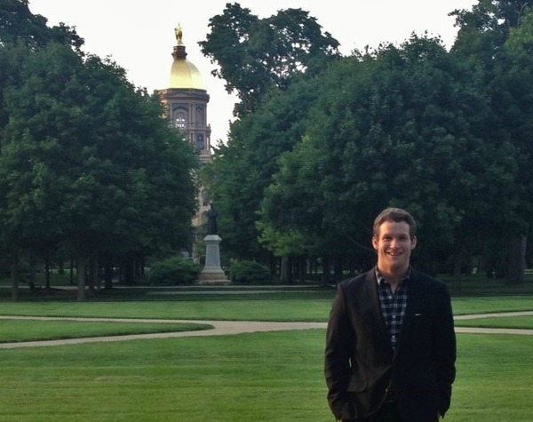 ESTEEM student Derek Athy stands in front of the Golden Dome
