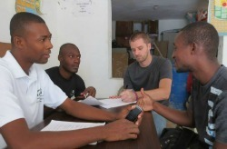 Dustin - third from left - meets with local Haitians