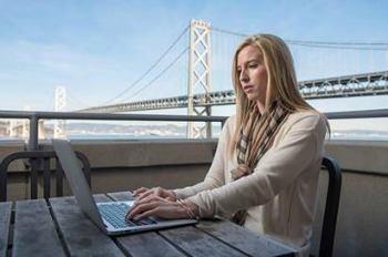 Photo of Student Studying with San Francisco Bridge in the Background